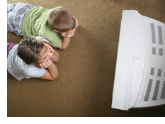 Photo of two children watching television