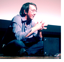 Will Wright, video game developer extraordinaire, takes questions from the audience while sitting on stage